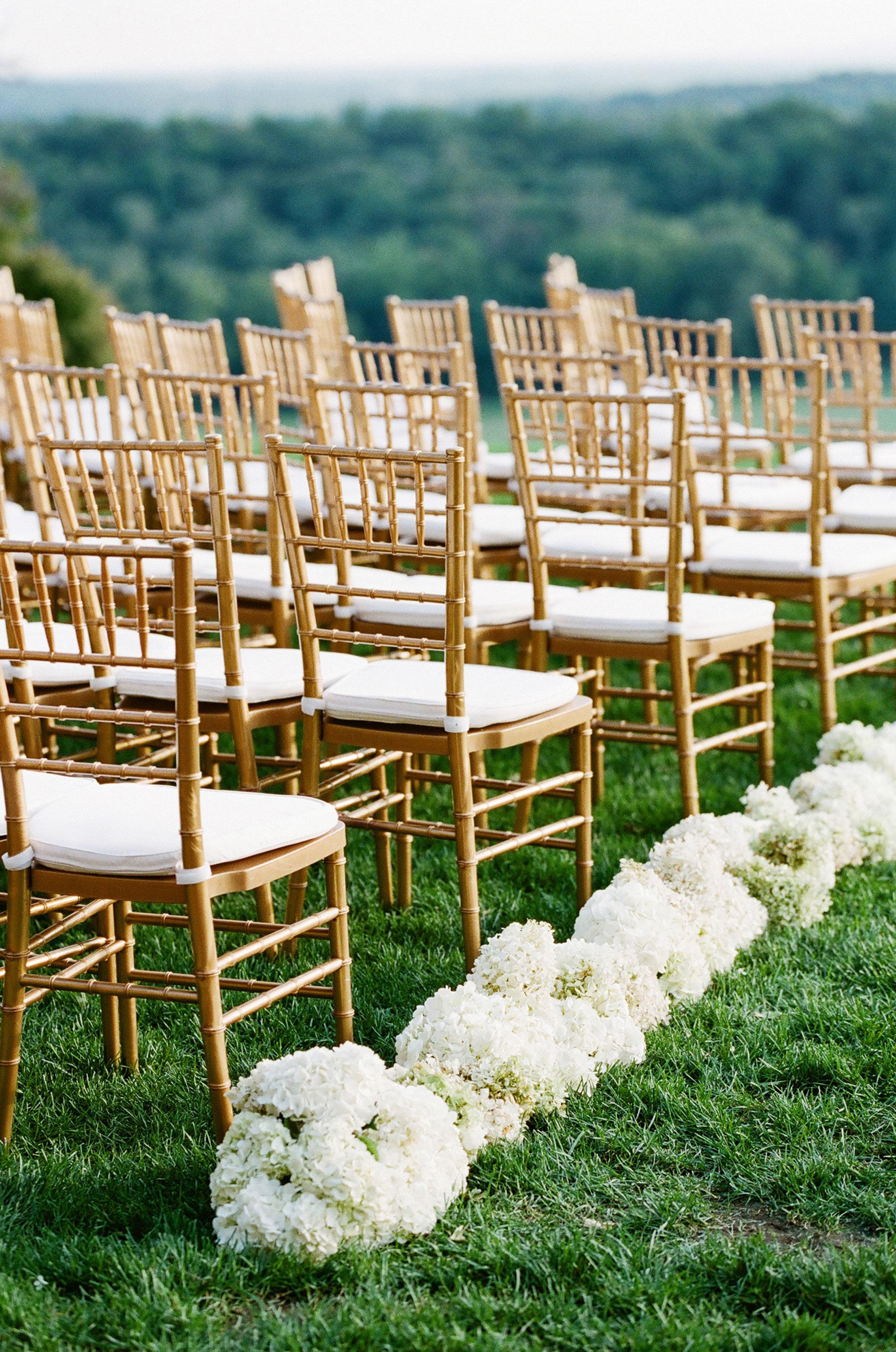Hydrangea outdoor wedding ceremony aisle decor by David Beahm Experiences